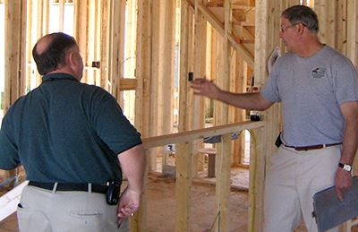 Building inspectors checking a house under construction